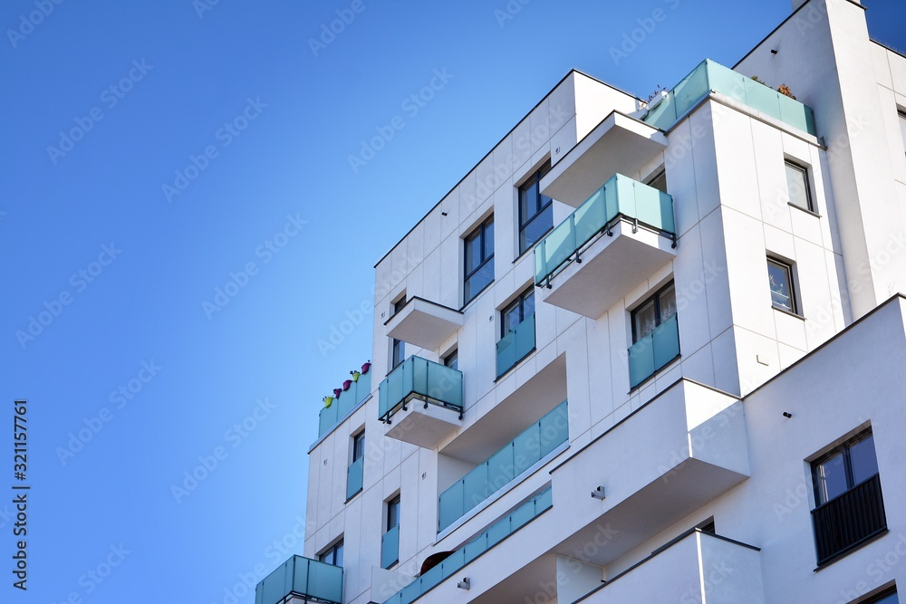 Fototapeta Contemporary residential building exterior in the daylight. Modern and new apartment building.