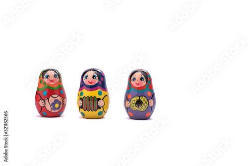 traditional russian souvenir matryoshka, three babushka doll in a row Canvas Print