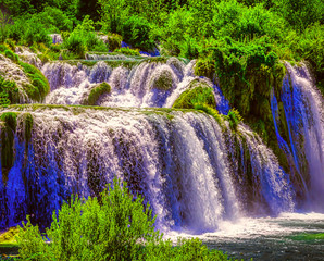 Obraz na Szklebeautiful river waterfalls in the forest closeup