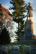 Private Soldier Monument At The Antietam National Cemetery In Sharpsburg, Maryland, USA With Headstoned In Foreground, Evening Light
