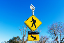 Pedestrian Crossing Sign With Solar Powered Flashing Lights. Crosswalk Beacon Provides Advance Notice Of Pedestrian Activity For Drivers