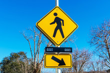 Pedestrian Crossing Sign With Flashing Lights. Crosswalk Beacon Provides Advance Notice Of Pedestrian Activity For Drivers