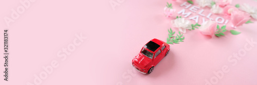 Photo small red car toy airplane lucky by flower