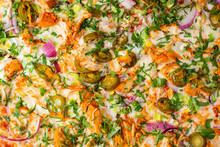 A Top Down View Of A Pizza With Chicken And Jalapeno Toppings.