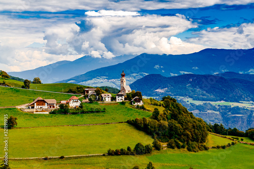 Photo Landscape with a little village in South Tyrol, Renon-Ritten region, Italy