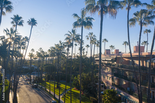 Fotografija Stunning aerial view of Beverly Hills neighborhood, Beverly Hills Hotel, and Sunset Boulevard surrounded with palm trees in Los Angeles, California