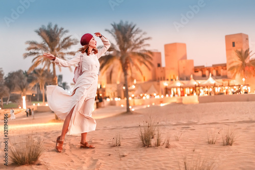 Happy asian woman in turban travels in Sahara desert Canvas Print
