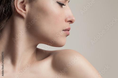 Obraz na plátně natural beauty concept young woman  profile  face closeup studio shot