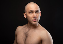 Photo Of Bald Puzzled Man With...