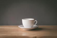 Cup Of Coffee On Wooden Table With Grey Background
