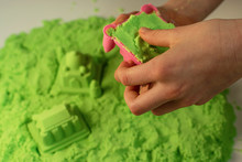 Kinetic Sand. A Child Plays Wi...