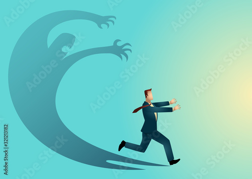 Businessman frightened with his own shadow Wallpaper Mural