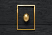 Golden Egg In Frame On Black W...