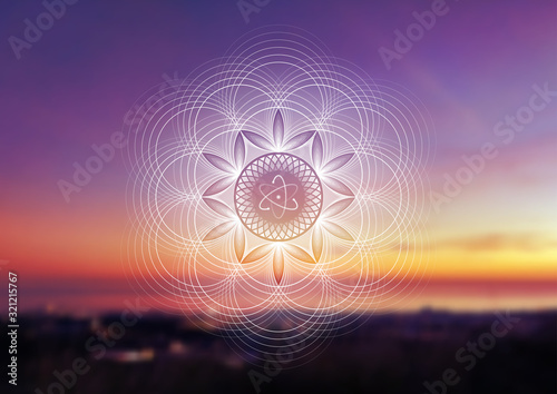Obraz Vector template of banner with spiritual sacred geometry on blurred background with sky and sea, horizontal format; Fantastic mandala and atom; Poster for yoga, meditation, relax. - fototapety do salonu