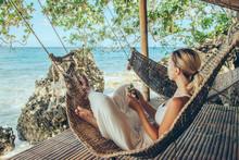 Woman Relaxing In Hommack On T...