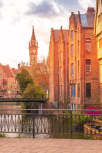 Downtown Of Ghent, Belgium With Canal, Clock Tower, Medieval Buildings
