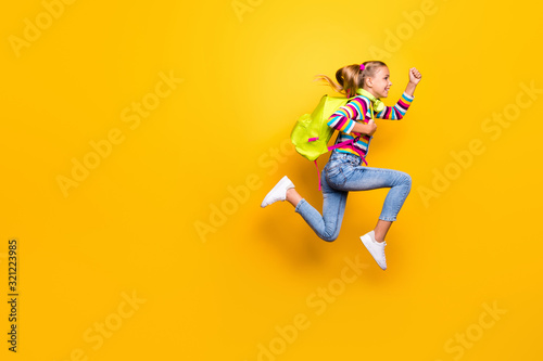 Leinwand Poster Full length photo of cheerful kid jump run speedy lesson wear striped sweater de