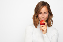 Portrait Of Happy Young Woman With Red Apple