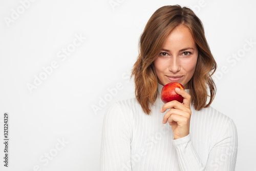 Obraz portrait of happy young woman with red apple - fototapety do salonu