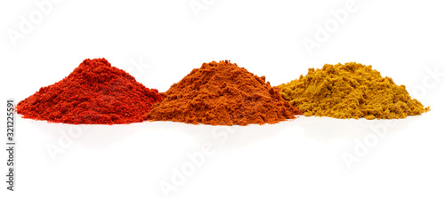 Three piles of spices. Fototapeta