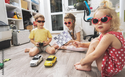 Children's hobbies: Children play at home with radio-controlled models of cars and organized racing competitions Tapéta, Fotótapéta