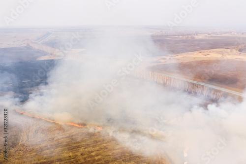 Field fire, aerial drone view Wallpaper Mural