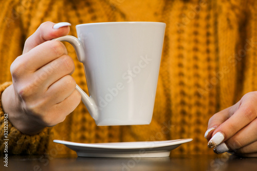 Fototapeta hands holding a cup of coffee obraz