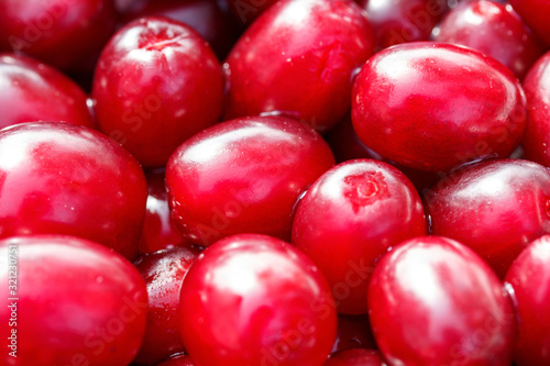Fresh ripe red cornelian cherries as a background Canvas-taulu