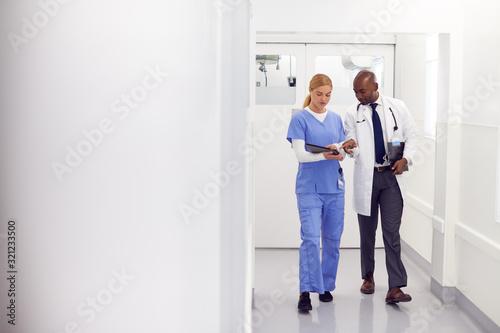Doctor In White Coat And Nurse In Scrubs Looking At Digital Tablet In Hospital C Tapéta, Fotótapéta