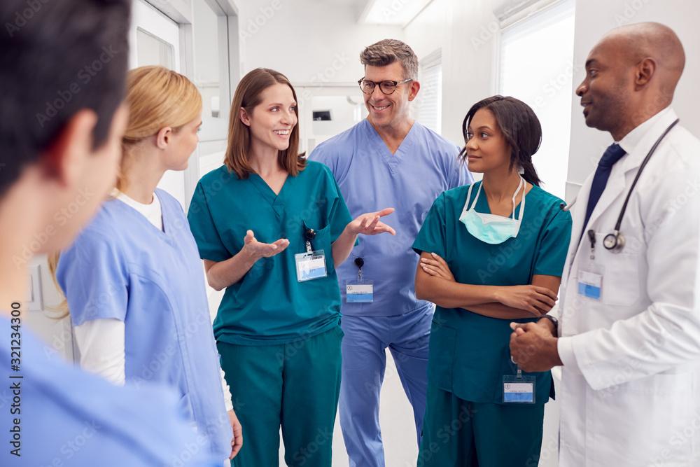 Fototapeta Multi-Cultural Medical Team Having Meeting In Hospital Corridor