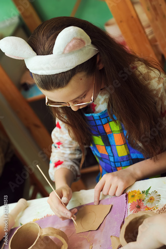 girl in the workroom for making clay products Wallpaper Mural