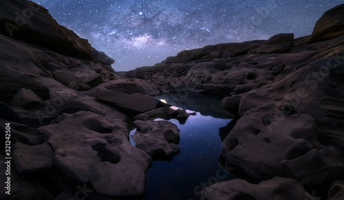 High rock cliffs with the Milky Way galaxy and reflections Canvas Print