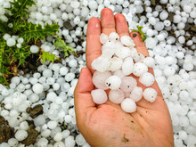 Big Hailstones In The Hand With Hailstones In Background