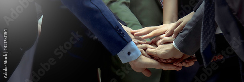 Obraz Creative team meeting hands together synergy brainstorm business man woman, asian people teamwork acquisition, brainstorm business people concept. Startup friends creative people sale project banner - fototapety do salonu