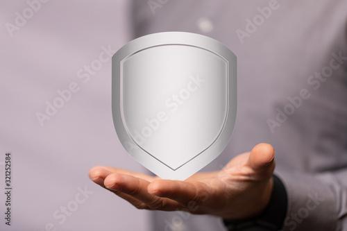 Fototapeta shield protection concept holding in hand digital obraz