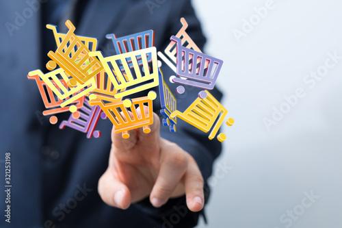 Fototapeta Online shopping business concept selecting shopping cart. obraz