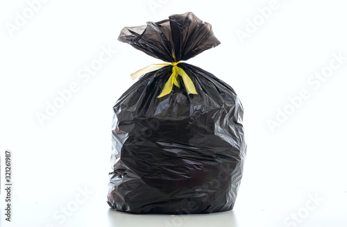 Photo Trash, black garbage bag full and tied isolated against white background
