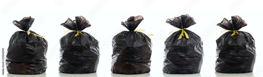 Fototapeta Trash, black garbage bag full and tied isolated against white background