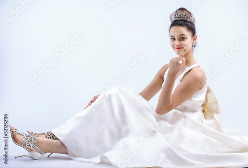 Valokuvatapetti woman in bridal dress showing middle finger. Copy space