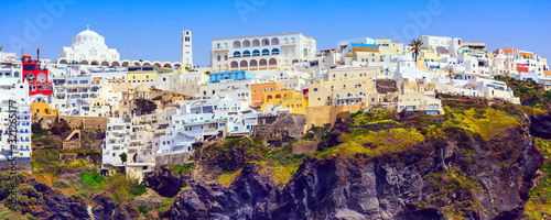Obraz Fira or Thira, Santorini, Greece panoramic banner with white and blue colorful houses on high volcanic rocks - fototapety do salonu
