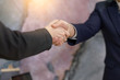 Business people shaking hands, finishing up meeting. Businessmans handshake. Business partnership meeting concept. Successful businessmen handshaking after good deal.