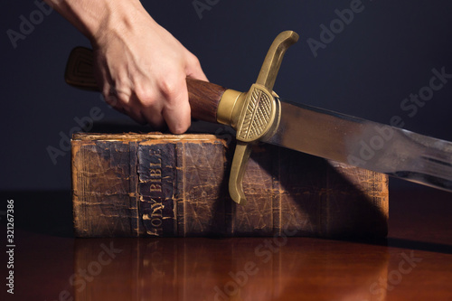 Young Athletic Man with His Bible and Sword Fototapete