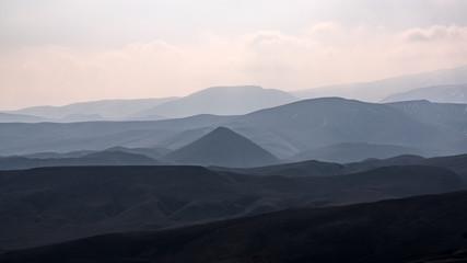 Mountain terrain in haze landscape