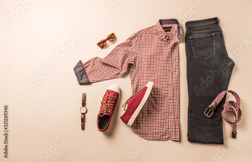 Fototapeta Men's casual fashion outfit - jeans, plaid shirt and red sneakers obraz