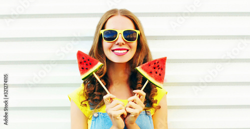 Fototapeta Portrait happy smiling young woman with ice cream shaped watermelon over white background obraz