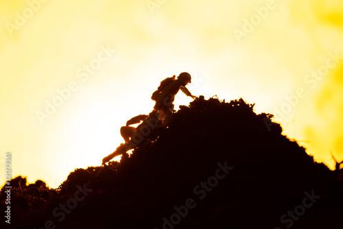 Fototapeta Battle scene with toy warriors on battleground and fire on yellow background obraz