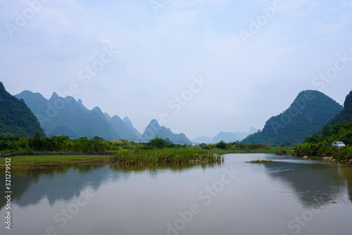 Fotografie, Obraz Beautiful karst mountains landscape and the Yulong river in Yangshuo County, Gui