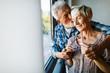 Leinwandbild Motiv Happy senior couple in love hugging and bonding with true emotions at home