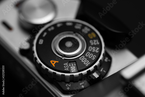 Fotografie, Obraz Shutter speed dial with exposure compensation values on a vintage film camera