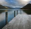 Rotoroa Lake New Zealand. Mountains sunset. Jetty